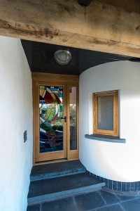 Front Door with stained glass from Stonegate Studio